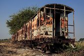 stock photo of covered wagon  - The old train on the rail cover by plant and sky - JPG