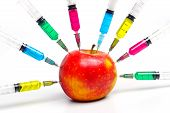 stock photo of genetic engineering  - Injection into red apple  - JPG