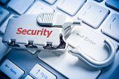pic of cybercrime  - broken security lock on computer keyboard  - JPG