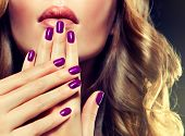 foto of manicure  - Girl with purple manicure and curled hair - JPG