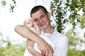 happy young father with baby girl