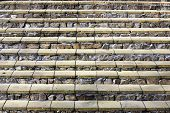 picture of stepping stones  - Horizontal steps of a ladder from yellow bricks and granite rough stones background - JPG