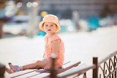 foto of jumpsuits  - Cute little girl in a pink Panama with white polka dots and pink summer jumpsuit with white polka dots - JPG