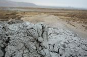 stock photo of ooze  - consolidated mud spew out mud volcano near Baku Azerbaijan - JPG