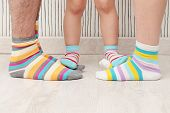picture of stocking-foot  - feet of a beautiful father mother and daughter with striped socks - JPG