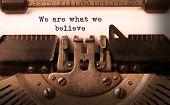 stock photo of old vintage typewriter  - Vintage inscription made by old typewriter we are what we believe - JPG