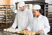 picture of pastry chef  - Bakers looking at trays of dough and pastry in the kitchen of the bakery - JPG