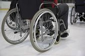 stock photo of paralympics  - The invalid person on the wheelchair on the ice - JPG