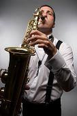 stock photo of sax  - closeup portrait of playing saxophonist - JPG