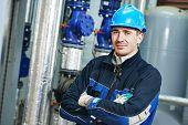 picture of boiler  - industrial heat engineer worker plumber at boiler room - JPG