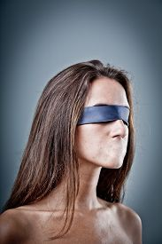 stock photo of freedom speech  - woman without her mouth representing lack of freedom of speech and that there is heavy censorship - JPG
