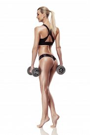 pic of tanga  - Nice sexy woman doing workout with dumbbell isolated over white background - JPG