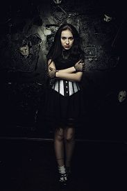 picture of gothic girl  - Pretty gothic girl with black eyes over grunged background