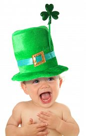 stock photo of shamrocks  - Funny St Patricks day baby wearing a green hat with a shamrock - JPG