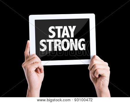 Tablet pc with text Stay Strong isolated on black background