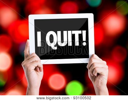 Tablet pc with text I Quit with bokeh background