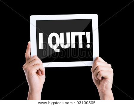 Tablet pc with text I Quit isolated on black background
