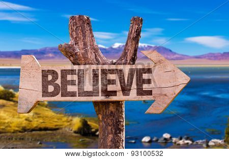 Believe direction sign with landscape background