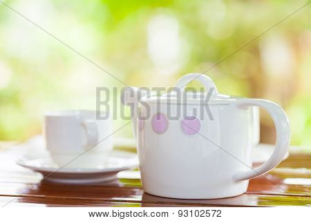 White Porcelain Set For Tea Or Coffee On Wooden Table