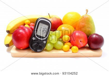 Glucose Meter And Fresh Fruits On Wooden Cutting Board