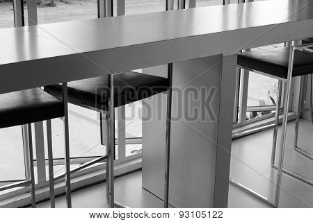 Black Leather Bar Stool Beside The Window