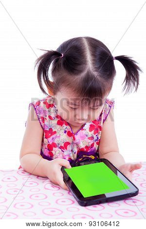 Adorable Little Asian (thai) Girl Using Digital Tablet At Desk