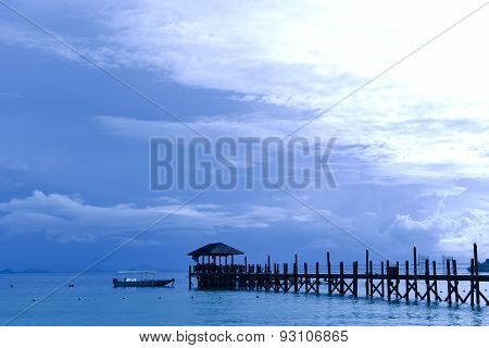 Wooden Bridge To The Cabin On The Seashore