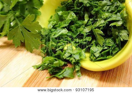 Fresh, Natural And Chopped Parsley On Wooden Cutting Board