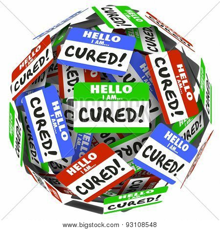 Hello I Am Cured words on a ball of name tags to illustrate getting better and healthy with treatment, therapy and medicine from doctors