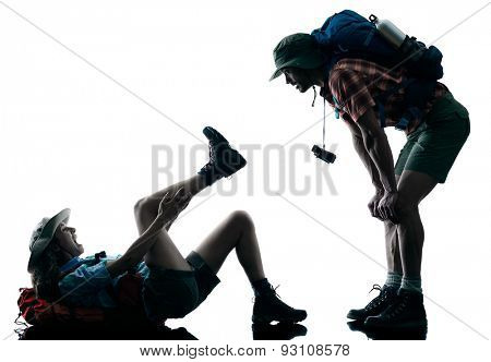one caucasian couple trekker trekking injury accident nature in silhouette isolated on white background