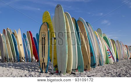 JACKSONVILLE BEACH, FL. USA - JUNE 6, 2015: Surfboards are staged on the beach for the Ocean Paddle part of the Never Quit Trident event which involves a 5k Run, 500M Ocean Swim and 1.5k Ocean Paddle.