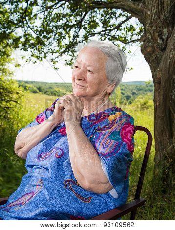 Old Woman Sitting And Praying