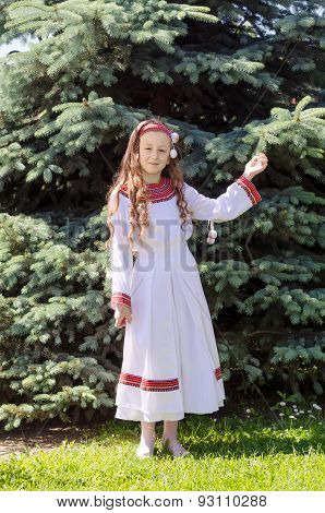 Nice Little Girl In The National Claim Stands Near A Fir-tree