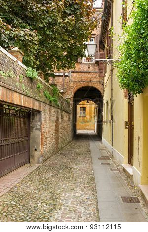 Small Ancient Street In The Old Downtown Of Ferrara, Italy