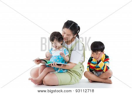 Mother With Her Child, Daughter Reading A Book, Son Feel Bad (different Gesture). Isolated On White
