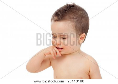 Nice baby with sore gums isolated on a white background
