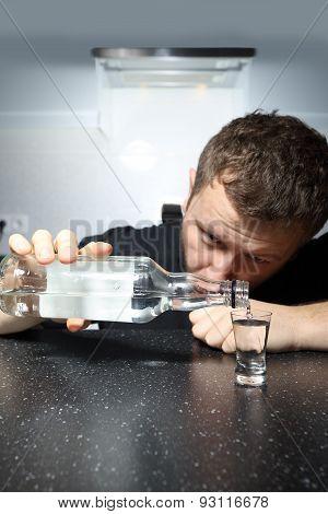 Drunk Man Pours A Glass Of Vodka
