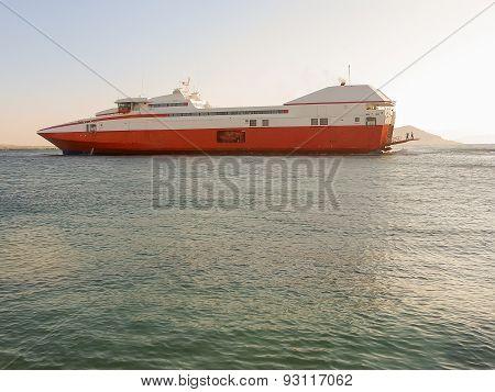 Catamaran leaving port. Vacation time.