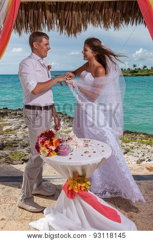 Young Loving Couple Wedding In Gazebo