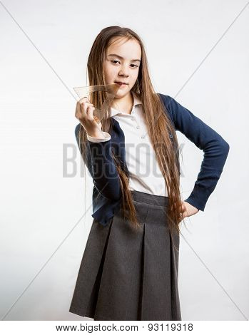 Cute Brunette Schoolgirl Posing With Plastic Protractor