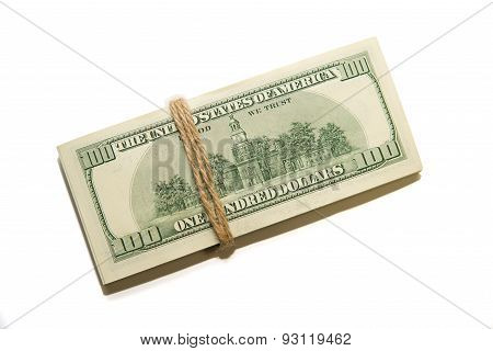 Bundle Of Us Dollars Banknotes On A White Background