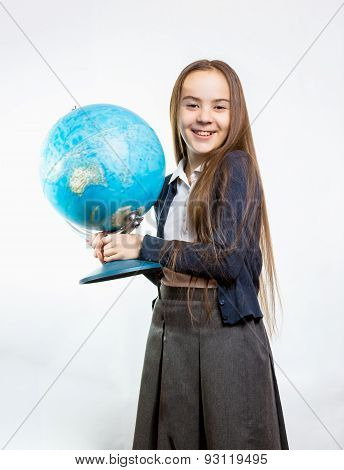 Happy Schoolgirl Posing With Globe Against White Background