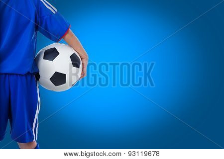 Back View Of Youth Soccer Player In Blue Uniform