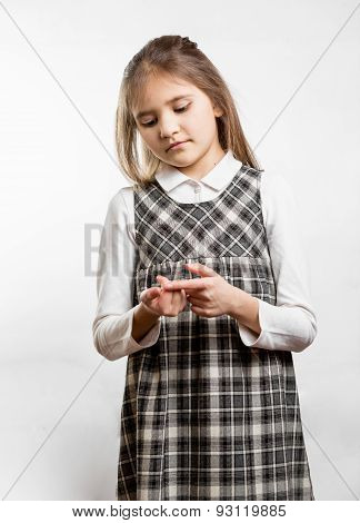 Little Schoolgirl Counting On Fingers