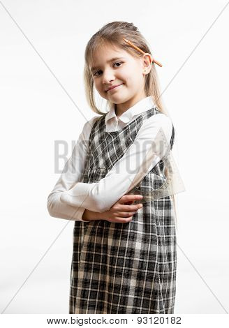 Portrait Of Cute Smiling Schoolgirl With Pencil Behind Ear