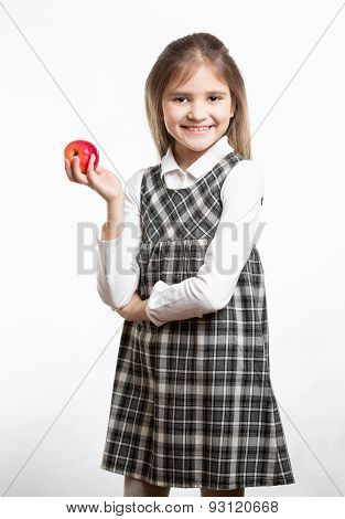 Cute Schoolgirl Holding Red Apple Against White Background