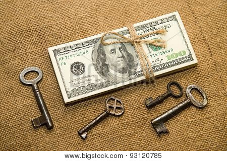 One Pack Of Dollars And Keys On An Old Cloth