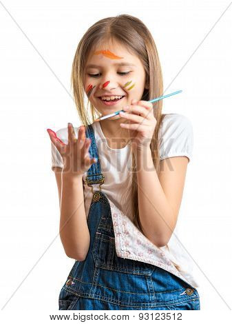 Smiling Little Girl Drawing On Her Hands With Paintbrush