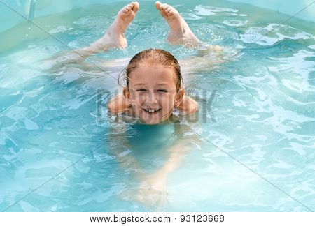 The Child Swims In The Pool