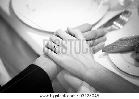 Bride And Bridegroom In Wedding Marriage Reception Holding Hands
